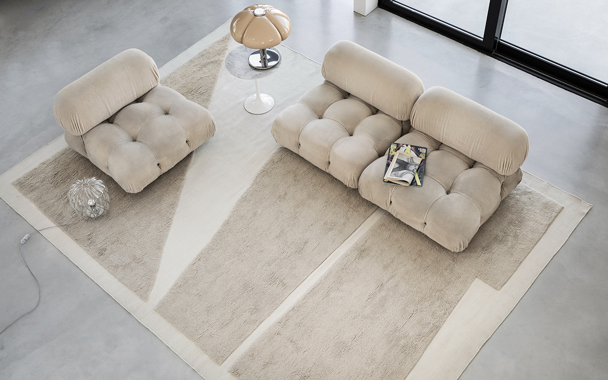 Bird-eye view over Untitled 2 in Cream and Almond, displayed with a beige sofa.