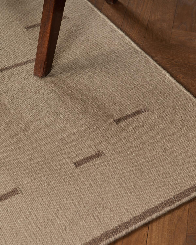 Close up of the Rain Beige flat-weave rug.