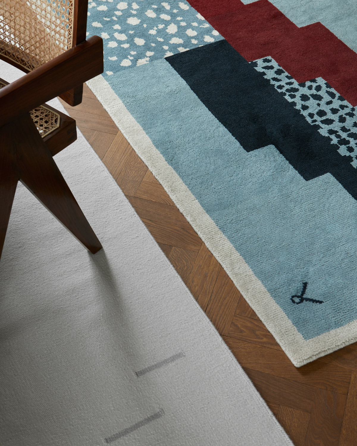 Close up of the Rain Beige rug and Art Deco Blue rug.