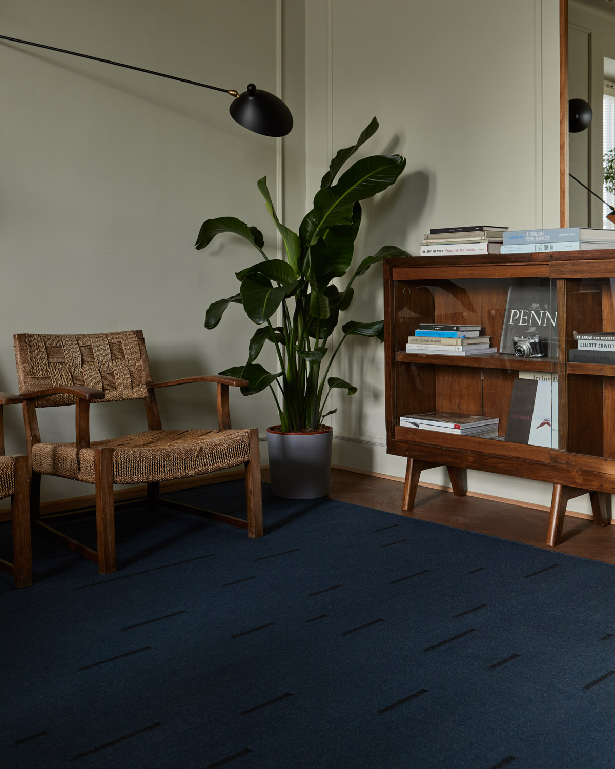 The Rain flat-weave rug in Teal in a Stockholm apartment with vintage decor.