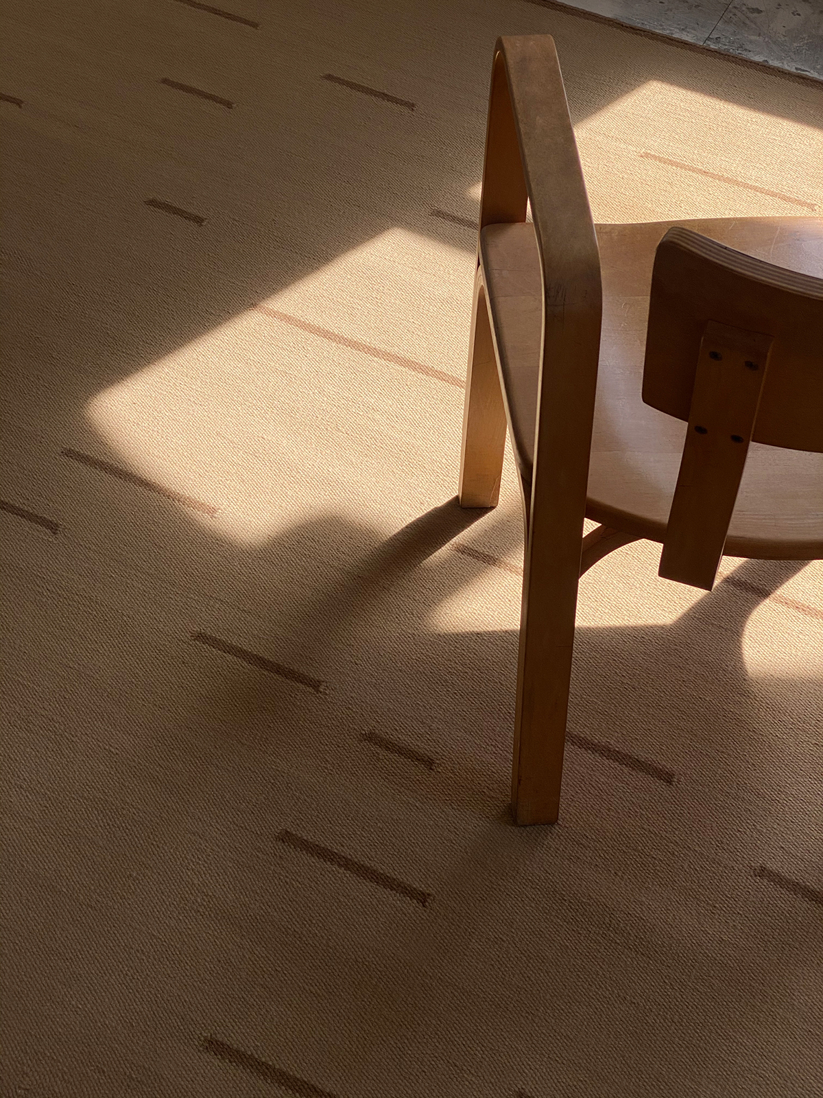 Sunny closeup of flatweave rug Rain in color Beige.