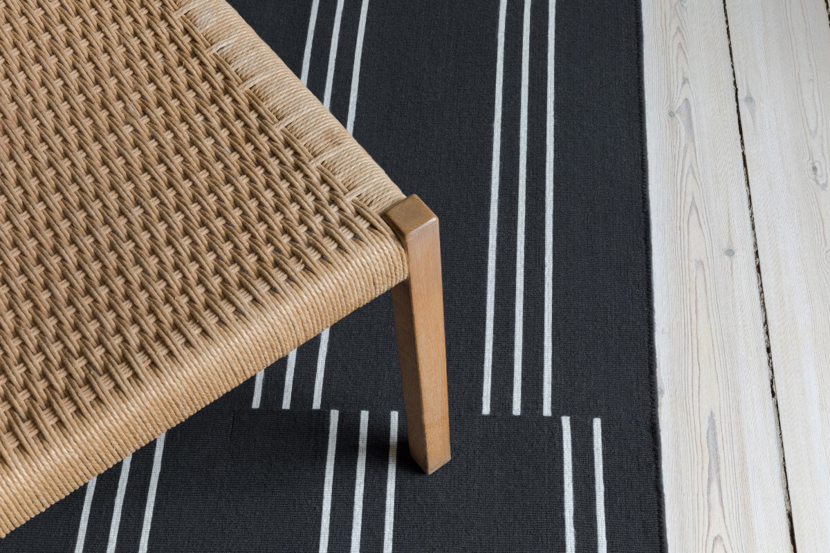 Close up of flatweave rug Stripes in color Anthracite.