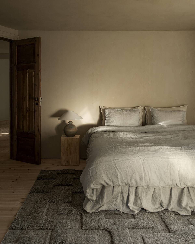The Boho Wool Rug in a beautiful bedroom.