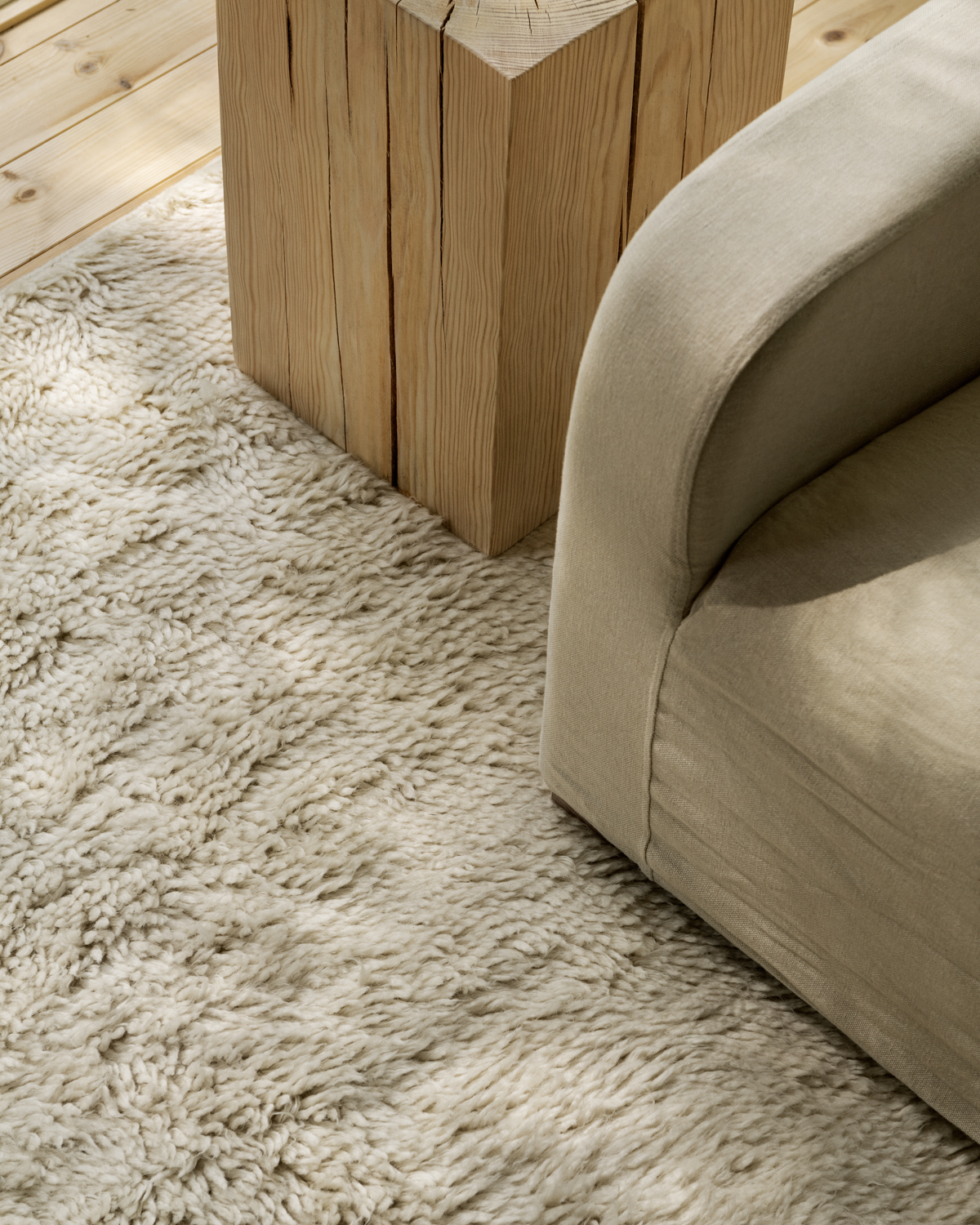 Details of Fields Sand shaggy wool rug in a house in the woods